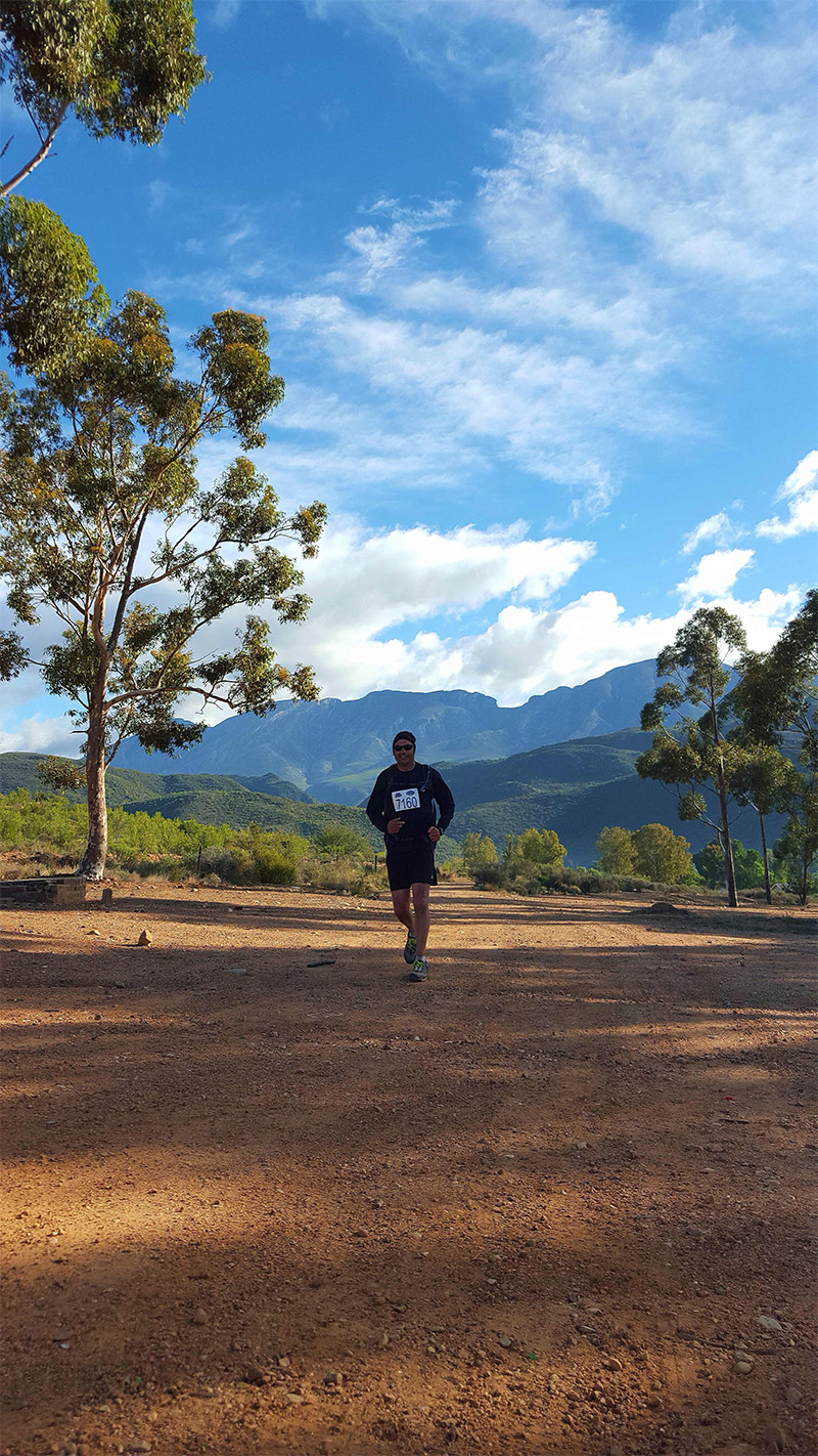 Trail runner with Swartberg Mountains in the background